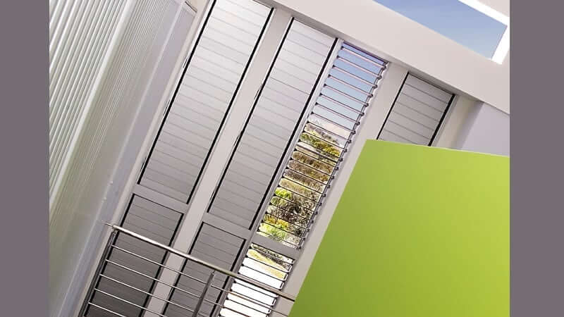 Tall banks of louvres with aluminium blades