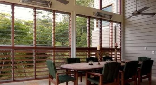 Louvre windows with glass on top and western red cedar blades on bottom