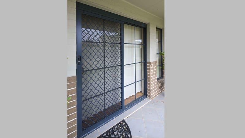 A sliding diamond grille screen door