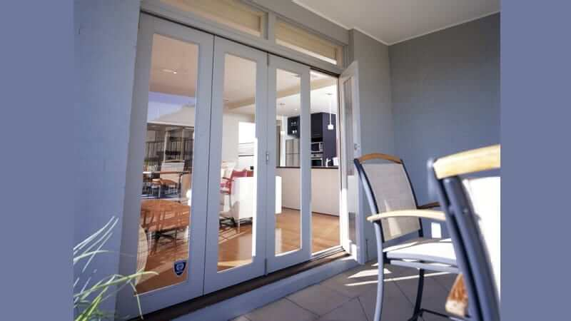 Bi-fold door in white frame
