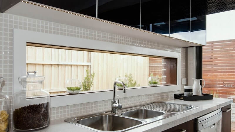 Fixed lite as a splashback in a kitchen