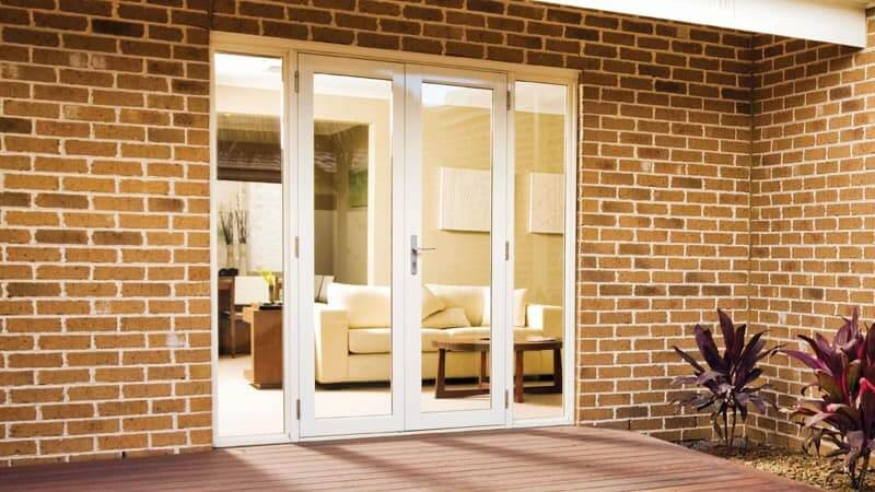 White framed French doors with sidelites - outside view
