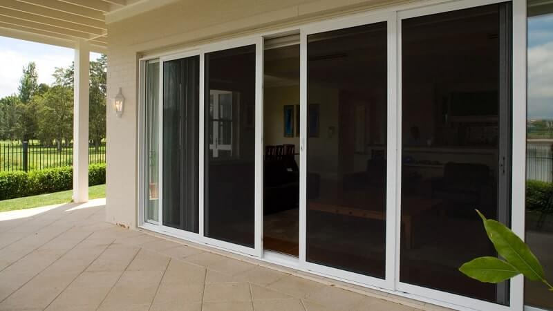 Invisi-Gard sliding screen doors on a OXXXXO configuration centre opening stacker door